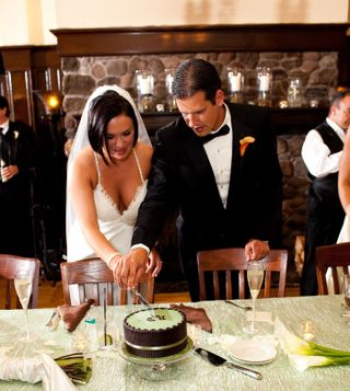 Chocolate-sage-wedding-cake-cutting