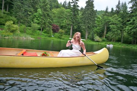 Bride-in-canoe-relaxing-wedding
